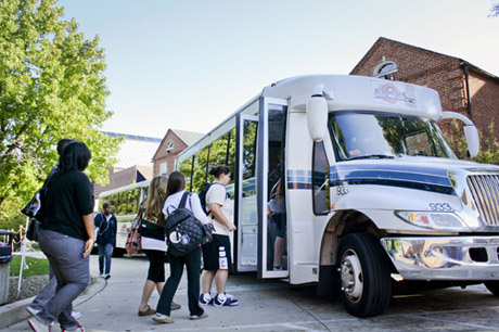 students boarding the shuttle